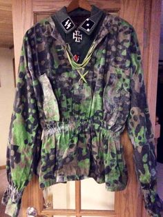 """Tunic and camo smock of a SS untersturmfuhrer from the 2nd SS panzer division """" Das Reich """""""