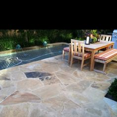 Stone patio idea -- also like this stone!