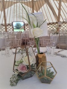 Elegant table centre by The Little Wedding Shed