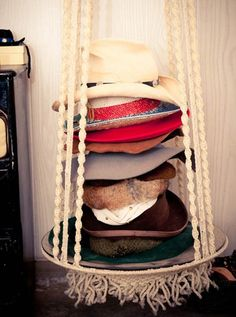 18 Hat Organizing Ideas For Summer // closet & wardrobe storage // stacking hats on a bohemian hanger