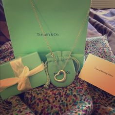"""Tiffany medium open heart pendant Elsa Peretti Open Heart Pendant.  Size medium.  16"""" chain.  Includes Tiffany bag, pouch, box with ribbon and sterling silver care card.  It's been worn but in excellent condition.  No receipt but it's 100% authentic as you can see I do not sell anything fake in my closet!  No trades, no PayPal and price firm.  This retails for $275 + tax.  It's currently out of stock online but you can check out full description. Tiffany & Co. Jewelry"""