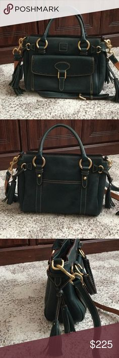 """Dooney and Bourke Details H 8.25"""" x W 5"""" x L 11"""" One outside snap pocket. One outside pocket. Two inside pockets. One inside zip pocket. Cell phone pocket. Inside key hook. Adjustable, detachable strap. Handle drop length 4.25"""". Strap drop length 24.5"""". Lined. Feet. Zipper closure..  no marks or stains inside or out from a smoke free home Bags Satchels"""
