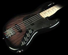 fender custom shop -,masterbuilt jazz bass. transparent black.