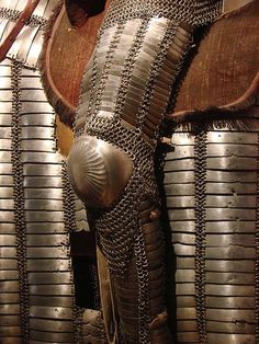 Ottoman Empire mail-and-plate dizcek (cuisse or knee and thigh armor) as worn by fully armored cavalryman (sipahi) in conjunction with migfer (helmet), krug (chest armor), zirah (mail shirt), kolluk/bazu band (vambrace/arm guards), and kolçak (greaves or shin armor). Les Invalides Museum of Arms and Armor, Paris France.