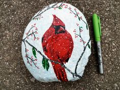 Cardinal bird in snow rock painting