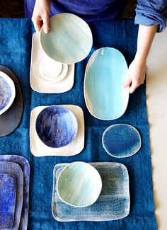 Utterly simple ceramic platters, cheese boards, plates, and bowls.