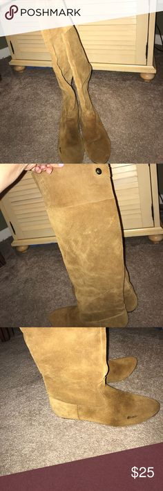 Leather knee high boots Tan leather boots- knee length for a wide calf , also can be worn pushed down to ankles. A staple brown boot for your closet. There is a spot on the right pinkie toe area of the boot that is about 1 inch long. Shoes Over the Knee Boots
