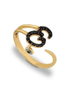 Δαχτυλίδι με Μονόγραμμα Χρυσό 14Κ Αναφορά 019176 Δαχτυλίδι από Χρυσό Κ14 με το μονόγραμμα (Ε) σε κίτρινο χρώμα και διακοσμημένο με ημιπολύτιμες πέτρες (ζιργκόν) σε μαύρο χρώμα. Επιπλέον, υπάρχει ένα ματάκι κρεμασμένο.