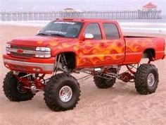 jacked up trucks that will never leave the paved streets of Los Angeles (except for a photo shoot on the beach)
