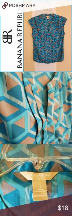 Banana Republic Geometric Shirt Blue Banana Republic Geometric cap sleeve dress shirt. 100% polyester. It has a thin loose elastic band at the bottom of the shirt hem. Supe Cute! EUC. Banana Republic Tops Blouses
