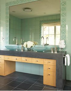 Dark, sea-glass green and pale wood bathroom with white accents.