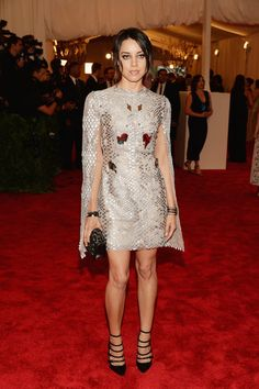 Aubrey Plaza sported a cape-like metallic minidress at 2013 Met Gala