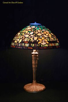 "16"" Tiffany Reproduction Banded daffodil       I've decided to repost my lamp shades page which includes 36 examples of my work. Most of ..."