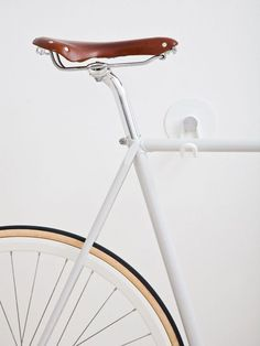 Great storage idea for bicycles, especially in small apartments. Bike Hooks / ALL WHITE GUM