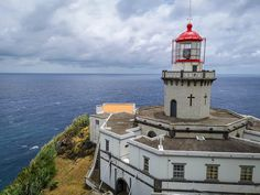 "São Miguel in the Azores is often called ""the green island"" because of the flora that covers it. Get some tips for what to see and do on São Miguel. Lighthouse, Portugal, Highlights, Island, Building, Travel, Tips, St Michael, Bell Rock Lighthouse"