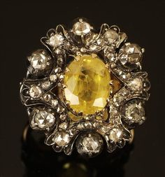 19th century yellow sapphire and diamond cluster ring.