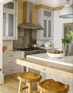 I LOVE THIS!!!  Kistchen waterfall island with rustic counter ledge for stools seating The Zhush: Rustic Modern Chic