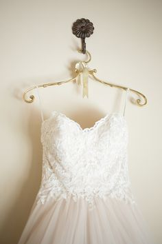 This antique-inspired bridal hanger from BHLDN is perfect for photographing your wedding gown.