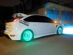 White Ford Focus ST RS with light rims and dark windows