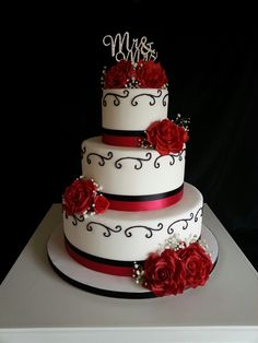 Red and black wedding cake with roses
