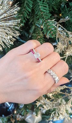 This 1.76 carat cushion cut diamond engagement ring is paired with a 1.31 carat ruby wedding band and an oval diamond eternity band. #cushion #cushiondiamond #diamond #engagementring #ring #ruby #rubies #weddingband #anniversaryband #eternityband