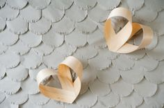 Photo backdrop: Grey paper scallop petal backdrop, bentwood hearts, prop styling by Honeycomb Collective.  Scandi Simple inspiration shoot for Hearten Magazine, Art Directed by Jeff Loves Jessica Photography.
