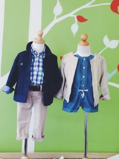 2014 Spring/Summer Apparel Collection. Left mannequin: Mayoral blue and white plaid button-up paired with Mayoral denim blue jacket and Mayoral khaki chino pant. Right mannequin: Mayoral denim romper with white polka-dot and lace detailing, paired with nude faux leather jacket.