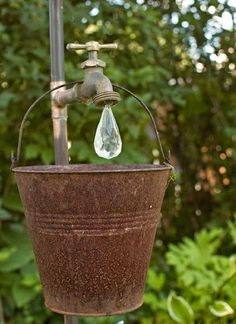 Dishfunctional Designs: The Upcycled Garden - Spring 2015 - love the gem water drop over this rusty bucket