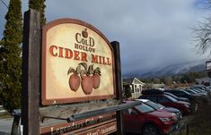 With its fresh-pressed apple cider and apple cider doughnuts, Cold Hollow Cider Mill in Waterbury Center is a Vermont visitor favorite. October Road, October Fall, Waterbury Vermont, New England Fall Foliage, Day Tours, East Coast, Travel Usa, Apple Cider, Places To Visit