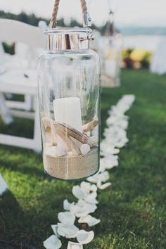 hurricane lanterns for a beach wedding - Carina Skrobecki Photography - http://ruffledblog.com/pacific-northwest-beach-wedding/