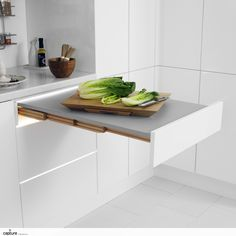 Pull out kitchen worktop is a perfect way to create more workspace, a great addition when space is at a premium. Storage solution, white gloss handless kitchen photography by http://capture.setvisions.co.uk/Portfolio
