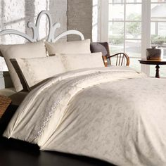 Find Peace 6-Piece Duvet Set Taupe Early Sunday mornings never looked of felt this good! The Find Peace duvet set is made with 100% Premium Cotton to ensure a soft, comfortable sleep. The set feautres a darling jacquard pattern and includes a flat sheet and 4 pillow cases. It is also available in white. Slightly over-sized, this duvet promises comfort and luxury.