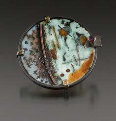 Love this torch-fire enameled brooch!
