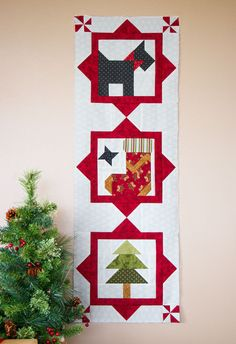 wall hanging, made with blocks from the Sleigh Bell Sampler by Sherri Falls | Fat Quarter Shop