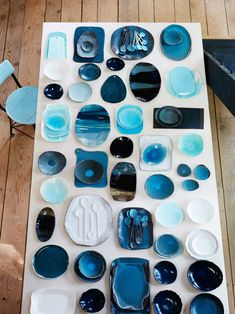 A collection of Michele Michael's blue pottery for her brand Elephant Ceramics sits on a table Ceramic Studio, Ceramic Clay, Ceramic Pottery, Modern Tree House, Blue Pottery, Ceramic Tableware, China Art, Paperclay, Celebrity Houses