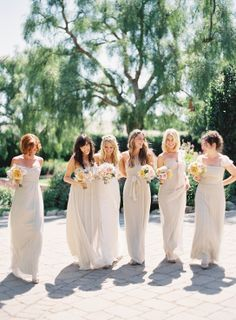 Pretty palette: bridesmaids in cream long dresses