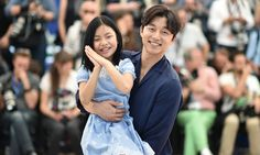 Actors Kim Su-an (left) and Gong Yoo, from the South Korean film Bu-San-Haeng (Train to Busan). Photograph: Alberto Pizzoli/AFP/Getty Images