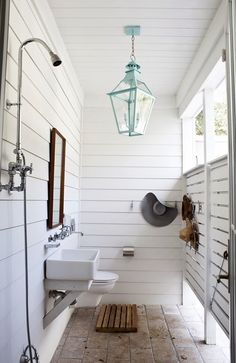 Modern outdoor shower with a turquoise lantern!