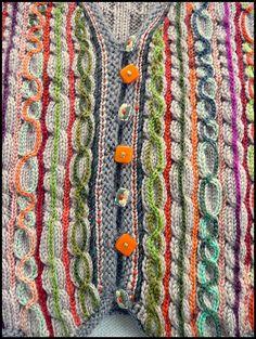 Les tricots d'Hélène Seners. Handmade. Sleeveless vest, chainstitched front, colored buttons. Available online.