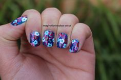Fancy Blue Nail Art With Colorful Flower Swirls And Dottes