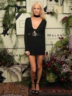 Taking the plunge: Poppy Delevingne made sure she commanded attention as she hosted a dinner party at West Hollywood's Chateau Marmont on Thursday night