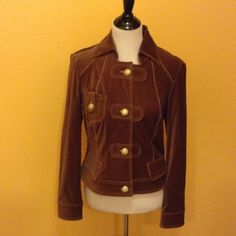 Soft brown jacket antique buttons beige stitching. Jacket has beautiful stitching, sleeves with buttons, flap on back with buttons, front pocket on right Cache Jackets & Coats