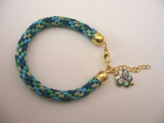 Kumihimo 8-strand round braid with Cloisonne butterfly charm by Bianca's Beads...find us on Facebook
