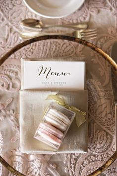 Macaron Favor on Neutral Place Setting   Photography: Laurie Bailey Photography. Read More:  http://www.insideweddings.com/weddings/oceanfront-wedding-ceremony-classic-romantic-ballroom-reception/854/