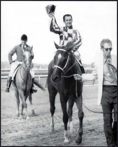 SECRETARIAT, Ron Turcotte & Hollis Chenery just after the finish of the 1973 Belmont Stakes. Ron tips his helmet to the cheering crowd