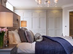 Wardrobes designed and made by The Secret Drawer. Painted in Farrow & Ball Purbeck Stone.