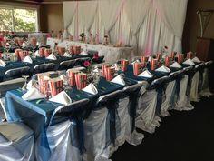Colourful movie themed wedding. Wedding reception decor ideas, chair covers, chair sashes.
