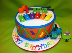 a vibrant colourful music based cake with matching cupcakes (inspired by a similar design at Dreamy cakes Brisbane)