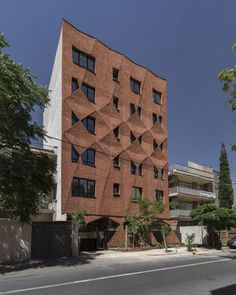 """Completed in 2016 in Tehran, Iran. Images by Parham Taghioff, Monireh Tafreshi       . Designing process  """"Woof Shadow"""" building is a 5-storey building with 10 apartments, located in a middle class block in Tehran. Our main challenge to..."""