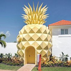 who lives in a pineapple under the sea? visitors to the nickelodeon resort in punta cana can live inside #spongebob's multi-faceted pineapple house. #designboom